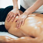 sports massage therapist massaging 6